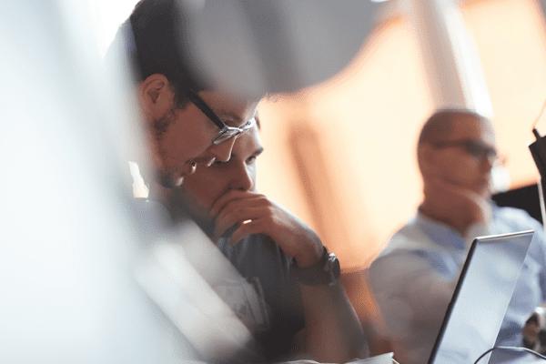 Three men analysing business intelligence software
